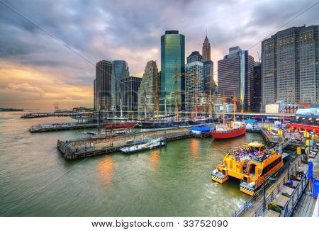 The historic district of South Street Seaport juxtaposed against the imposing Financial District skyscrapers.