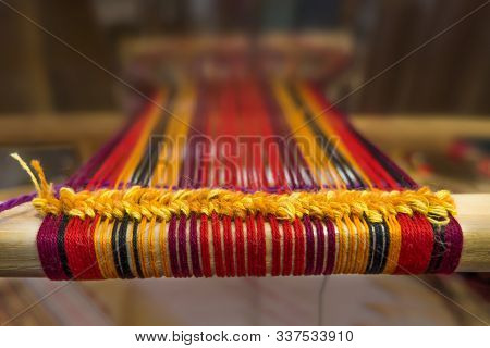 Manual Wood Loom. Hand Loom Background. Detail Of Traditional Vintage Weaving Hand Loom With Wool Cl