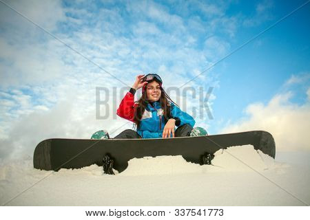 Young Woman In Winter Mountains With A Snowboard, Extreme Sports Leisure Activities
