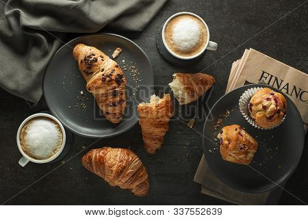 Breakfast Served With Croissants And Coffee. Continental Breakfast Table With Newspaper Concept