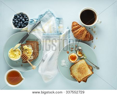 Continental Breakfast Meal Served With Coffee, Croissant, Egg, Bread, Honey And Butter. Delicious He