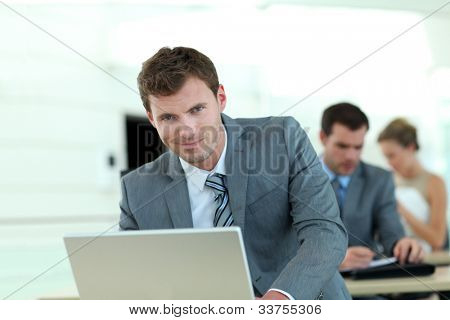Salesman in grey suit attending business training