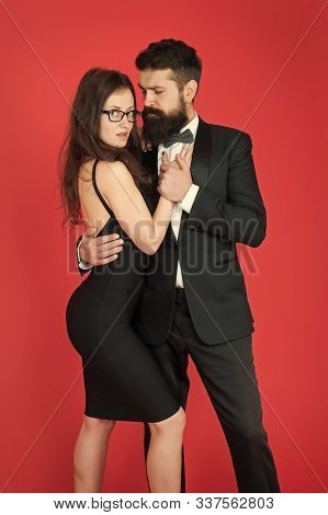 Temptation. Sexy Couple In Love. Formanl Couple In Tuxedo And Black Dress. Elegant Fashion And Beaut