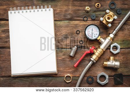 Plumbing Flat Lay Background With Copy Space. Work Tools, Pipeline Equipment And Blank Page Notepad