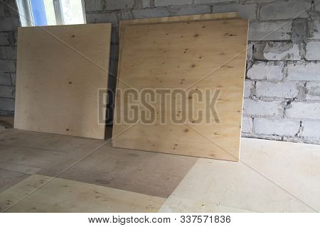 Plywood ,building Material. Production Of Plywood Floor. Installation Of Plywood On The Floor.