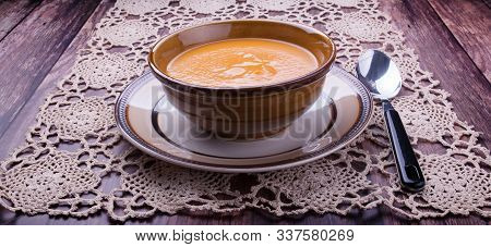 Closeup On A Carrot Cream-soup With Spoon