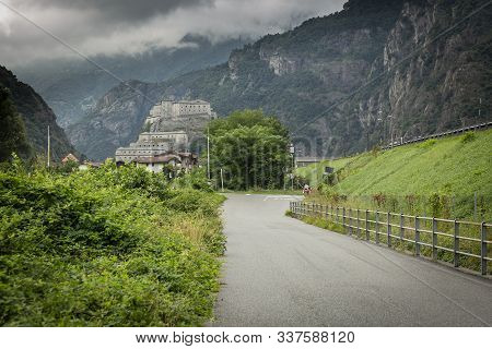 Paved Road To Hone Town And A View Of The Bard Fortress, Aosta Valley, Italy
