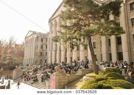 Seoul, South Korea - April 8 ,2019 Student Orientation Around Classic Building With  Cherry Trees Of