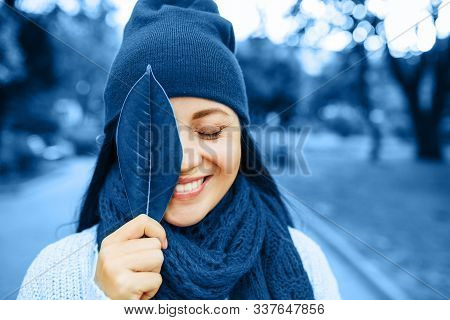 Blue Fashion Colors Autumn-winter Knits Pile. Beautiful Girl Outside In Hat And Scarf. Warm Cozy Hom