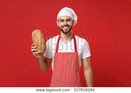 Smiling Young Bearded Male Chef Cook Or Baker Man In Striped Apron White T-shirt Toque Chefs Hat Iso