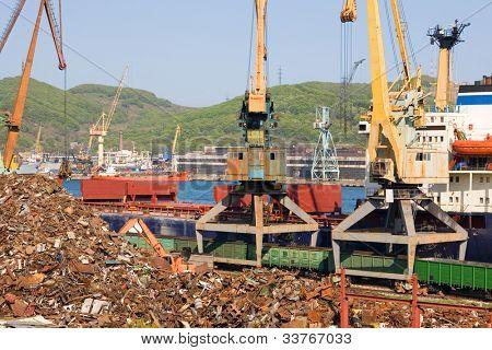 Recycling, loading scrap metal in the ship. Russia. Port of Nakhodka. Primorskiy Kray.