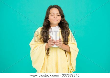 Happy Morning. Comfy Outfit For Weekend Rest At Home. Comfy Style. Kid Wearing Soft Poncho Drinking