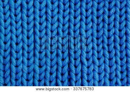 Beautiful Blue Knitted Texture For Background. Merino Wool Yarn.