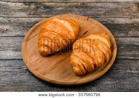 Two Croissants. Fresh French Croissant. On A Wooden Background. View From Above. Morning Breakfast W