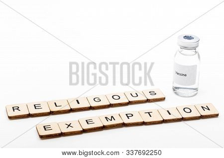 Vaccine Concept Showing A Medical Vial With A Vaccine Label On A White Background Along With A Sign