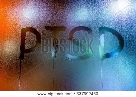 An Abbreviation Ptsd - Post Traumatic Stress Disorder - Handwritten On Wet Glass Of Night Window