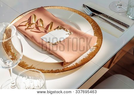 Wedding Banquet Table Setting With Decoration In Gold Color