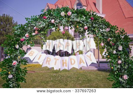 Arch Decor . Birthday Arch Decorated . Happy Birthday Texts. Woven Plants Forming An Arch In Beautif
