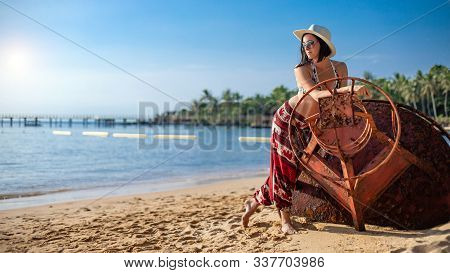 Young Woman On A Tropical Beach. Phu Quoc Island, Vietnam. On The Phu Quoc Island, Vietnam.