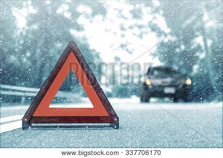 Snow Time Black Car Have Accident Park On Road. Red Triangle, Red Emergency Stop Sign, Red Emergency
