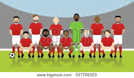 Line Up Of Eleven Multinational Male Soccer Players In Red Kit On Football Pitch. Eps File Available