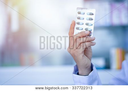 Medicines Arranged In Shelves At Pharmacy.