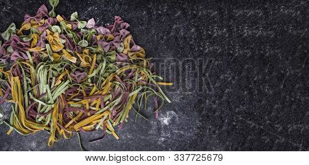 Homemade Pasta, Farfalle Bow-tie, Fettuccine Or Tagliatelle Colorful Pasta On Grey Background With F
