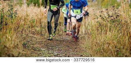 Group Of Runners Athletes Run Uphill Trail Vertical Kilometer