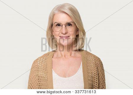 Headshot Of Mature Woman Wearing Glasses Looking At Camera