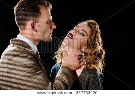Dangerous Gangster Choking Attractive Woman Isolated On Black