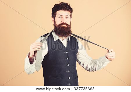 Start With Your Collar Up And The Tie Around Your Neck. Art Of Manliness. Man Bearded Hipster Try To