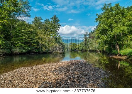 A Perfect Sunny Day Standing On The Riverbed Looking Downstream On The Hiwassee River In Tennessee W