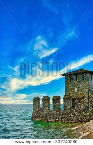 Vertical Photo Of Water Castle On Coast Of Famous Italian Lago Di Garda. Castle Is In Small Town Sir