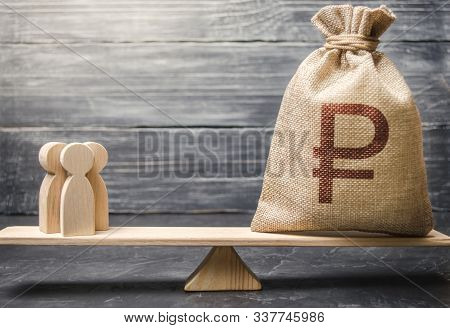 Russian Ruble Rub Symbol On Money Bag And People On Scales. Concept Attracting Investment, Business