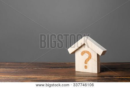 Question Mark On A Wooden House. Cost Estimate. Solving Housing Problems, Deciding To Buy Or Rent Re