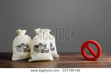 Money Bags And Red Prohibition Sign No. Restrictions On The Export Of Capital, Economic Pressure And