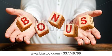 Cubes Thrown By A Man Make Up The Word Bonus. Receive Bonuses, Rewards And Preferences. Salary Incre