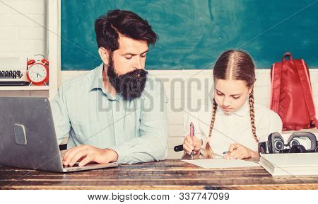 Homeschooling With Father. Find Buddy To Help You Study. Private Lesson. School Teacher And Schoolgi