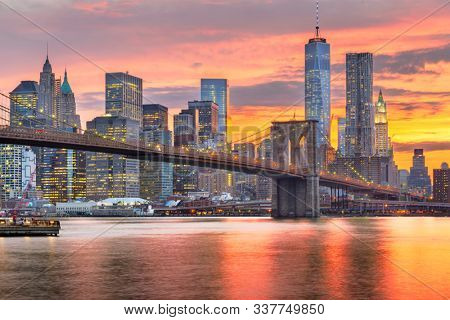New York, New York, USA Lower Manhattan skyline on the East River at dusk.