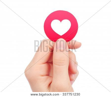 Kiev, Ukraine - May 15, 2019: Hand Holds New Facebook Love Empathetic Emoji Reaction, Printed On Pap