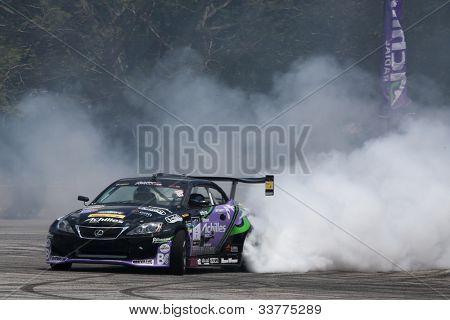KUALA LUMPUR - MAY 19: Japan's Daigo Saito in a Lexus SC430 burns up some rubber in a performance during the Formula Drift 2012 Asia Round 1 on May 19, 2012 in Speedcity, Kuala Lumpur, Malaysia.