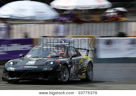 KUALA LUMPUR - MAY 20: Thailand's Nattawoot (Oat) in a RX-7 car from the M150 Storm Team drifts his car on the tarmac during the Formula Drift 2012 Asia Round 1 on May 20, 2012 in Speedcity, Malaysia.