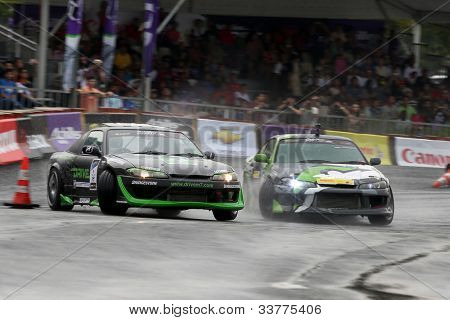 KUALA LUMPUR - MAY 20: Emmanuel Armandio (right) chases Tengku Djan (left) during the Formula Drift 2012 Asia Round 1 on May 20, 2012 in Speedcity, Malaysia. Tengku Djan won third place in this event.
