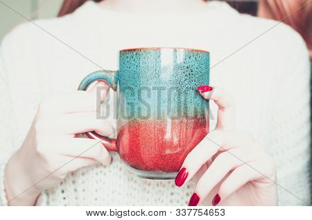 Woman Holding Tea Or Coffee Cup. Female Hands With Hot Drink. Blonde Girl With Bright Manicure In Wo