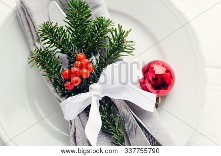 Festive Place Setting For Christmas Dinner. Christmas Table Setting In Scandinavian Style With Natur