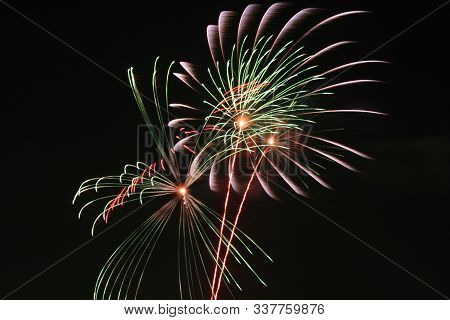 Colorful Fireworks On The Black Sky Background Over-water Celebration