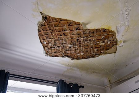 Part Of The White Plaster On The Ceiling Fell Off As A Result Of Flooding
