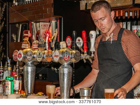 Melbourne, Australia - December 16, 2009: Cookie Thai Eatery And Beer Hall. Closeup Of Barman Tappin