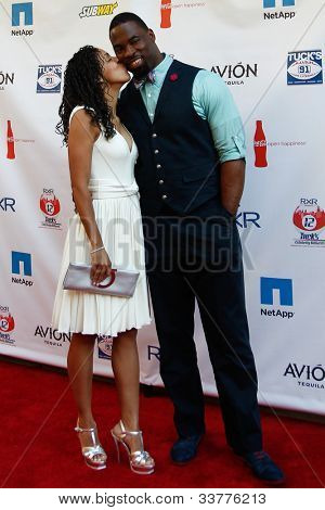 NEW YORK-MAY 31: Lauran and New York Giants Justin Tuck attend the 4th annual Tuck�s Celebrity Billiards Tournament on May 31, 2012 in New York City.