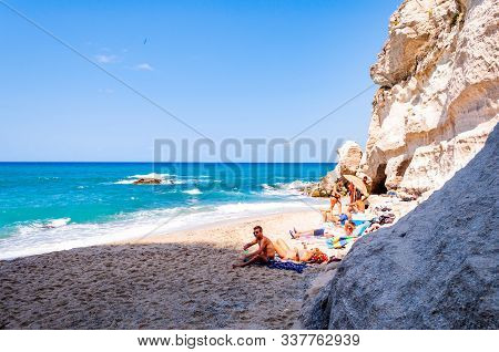 Tropea, Calabria, Italy - September 07, 2019: People Resting On Tiny Closed By Massive White Rocks B